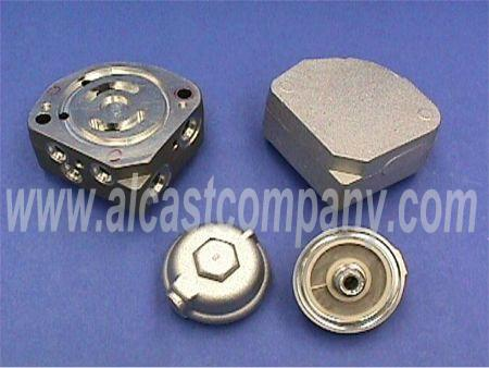 raw and machined hydrostatic manifold and filter cap aluminum castings